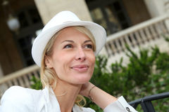 Beautiful middle-aged woman with fancy hat Royalty Free Stock Photos