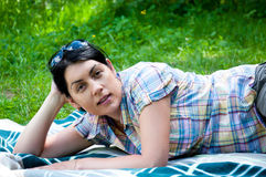 Beautiful middle-aged woman on grass Stock Photo