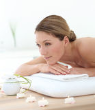 Beautiful middle-aged woman having a back massage Royalty Free Stock Photo