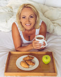 Beautiful middle aged woman at home Stock Photo