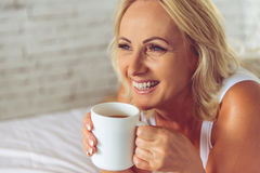 Beautiful middle aged woman at home Royalty Free Stock Photos