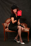 A beautiful middle-aged woman with a red gift Royalty Free Stock Photo