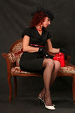 A beautiful middle-aged woman with a red gift Stock Images