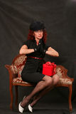 A beautiful middle-aged woman with a red gift Royalty Free Stock Image