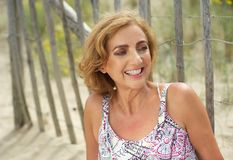 Beautiful middle aged woman relaxing outdoors Royalty Free Stock Photos