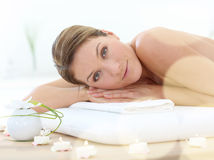 Beautiful middle-aged woman relaxing in spa center Stock Photography