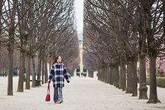 Beautiful middle aged woman walking in Parisian park Stock Images
