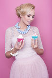 Beautiful middle aged women hold colorful sweets. Soft colors Stock Image