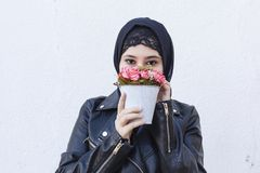 Free Beautiful Middle-eastern Girl Holding Decorative Basket Full Of Flowers. Cute Arabian Muslim Woman Received Unique Flower Bouquet Stock Image - 165768391