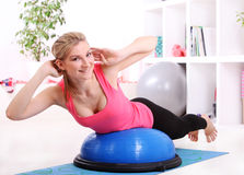 Beautiful middleaged woman doing fitness stock image