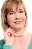 Beautiful middleaged woman on a white background Stock Photo