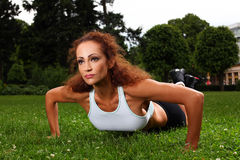 Beautiful middleaged woman working out Stock Photos
