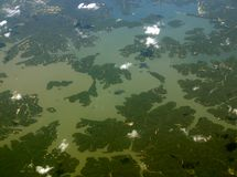 Beautiful Midwestern Lake. Ariel View at 32,000 ft of a lake in the middle of the US. Beautiful pattern. Nice little clouds and well branched lake Stock Images