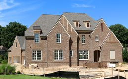 Beautiful Million Dollar Suburban Home Under Construction. View of a million dollar upper class suburban home under construction, located in the beautiful and stock image