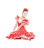 Beautiful mime in red dress sitting on the floor Royalty Free Stock Photos