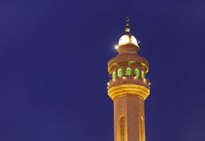 Beautiful minaret of Al Fateh Mosque of Bahrain at blue hours Royalty Free Stock Images
