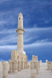A Beautiful minaret and archways of Khamis mosque Stock Photography