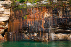 Beautiful mineral deposits on the rocks sandstone, Pictured Rock. Mineral colored sandstone on the cliffs Pictured Rocks National Lakeshore, Michigan, USA Stock Photography