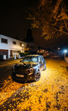 Beautiful Mini Cooper car parked in night city Royalty Free Stock Images