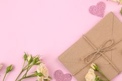 Beautiful mini roses and envelope on a bright pink background. holidays. Valentine`s Day. women`s Day. view from above royalty free stock images