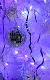 Beautiful mirror ball on a Christmas tree. White artificial Christmas tree in holiday decoration Stock Photos