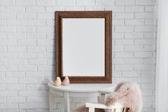 Beautiful mirror on table in modern room stock image