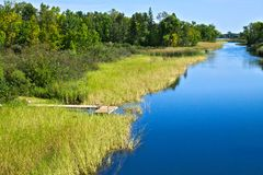 Beautiful Mississippi River flows north toward Bemidji Minnesota. Mississippi River flows north toward Bemidji Minnesota near hiway 2. This scene with boat docks royalty free stock photography