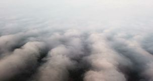 Beautiful misty dawn. Flying above the clouds, drone video stock footage