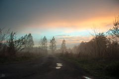 Beautiful misty evening. Unmade road on a beautiful misty evening Royalty Free Stock Photography