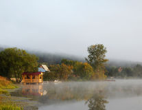 Beautiful misty landscape on the pond. With pavilion Stock Photos
