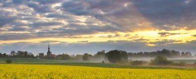 Beautiful, misty sunrise on a field near the village Royalty Free Stock Photo
