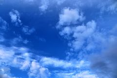 Beautiful mixed cloud formations with white and grey cumulus clouds in the sunlight on a blue sky. Seen in germany royalty free stock photos