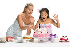 Beautiful mixed family. Caucasian mother and her asian daughter celebrate birthday Stock Photography