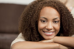 Beautiful Mixed Race African American Girl. A beautiful mixed race African American girl laying down with perfect teeth and smile Stock Image