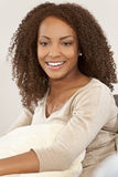 Beautiful Mixed Race African American Girl. A beautiful mixed race African American girl laying down with perfect teeth and smile Royalty Free Stock Image
