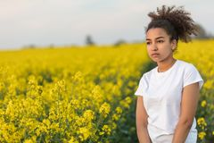 Sad Mixed Race African American Teenager Woman in Yellow Flowers Royalty Free Stock Photos