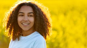 Happy Mixed Race African American Teenager Woman in Yellow Flowe Stock Photos