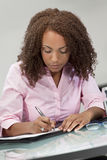 Beautiful Mixed Race African American Girl Writin Stock Photos