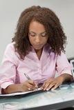 Beautiful Mixed Race African American Girl Writin stock photos