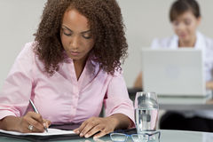 Beautiful Mixed Race African American Girl Writing Stock Image