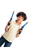 Beautiful Mixed Race Boy Playing with Toy Guns. Isolated on white studio background Stock Photo