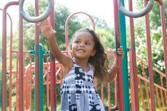 A beautiful mixed race child. Enjoying the playground Stock Images