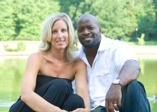 A beautiful mixed race couple. Enjoying the park Stock Images