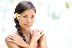 Beautiful mixed race girl natural beauty portrait. Outdoors on spa resort. Multi-ethnic Asian Caucasian female woman model with perfect skin. Skin care and spa Royalty Free Stock Photos