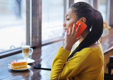 Beautiful mixed race girl talking on the phone Royalty Free Stock Photography