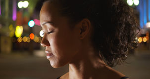 Beautiful mixed race woman athlete standing outdoors at night Royalty Free Stock Photo