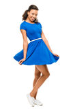 Beautiful mixed race woman dancing blue dress isolated on w Stock Photo