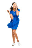 Beautiful mixed race woman dancing sexy blue dress isolated on w Stock Photos