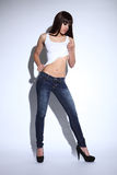 Beautiful mixed race woman in jeans and white vest Royalty Free Stock Images