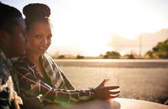 Beautiful mixed race woman looking into camera during outdoor date Royalty Free Stock Photos